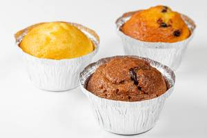 Three muffins with different fillings on a white background (Flip 2019)