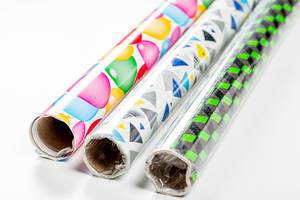 Three rolls of multi-colored gift wrapping paper