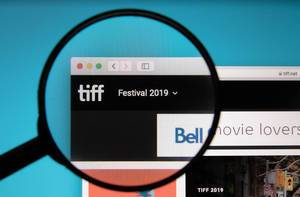 TIFF logo on a computer screen with a magnifying glass
