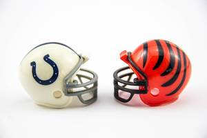 Tiny Football Helmets on White Background