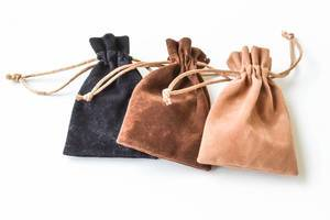 Tiny leather bags in three different colors