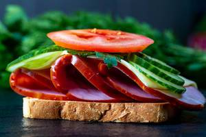 Toast with ham, cheese, cucumbers and tomatoes