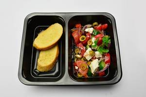 Toasts and salad with feta cheese and tomatoes