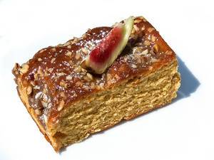 Toffee-hazelnut cake with piece of fig on top