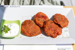 """Tomato """"keftes"""" with spring onions, fresh herbs and feta cheese at Aelia Restaurant Kassandra"""
