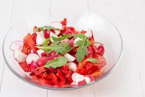 Tomato Radishes Rukola and Cheese Salad in the bowl (Flip 2019)