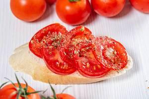 Tomato sandwich on white wooden background (Flip 2019)