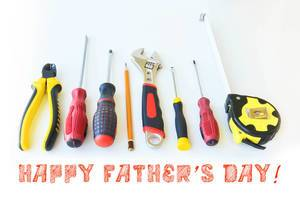 Tools isloated on white with the font Happy Fathers day