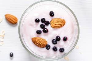 Top-view-black-elderberry-and-almond-nuts-with-yogurt-on-oatmeal.jpg