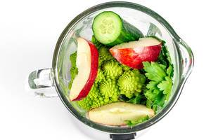 Top view , blender with fresh vegetables and fruit. The concept of cooking healthy food (Flip 2020)