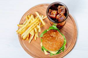 Top view Burger, fries and iced drink on round kitchen Board (Flip 2019)