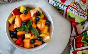 Top View Close Up Photo of Mixed Fruit Bowl with Spearmint