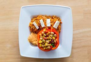 Top View Food Photo of Mexican Style Rice, Bell Pepper filled with Beans, Lentils and Corn