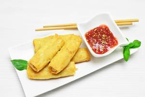 Top View Food Photo of Spring Rolls with Spicy Sauce on White Plate