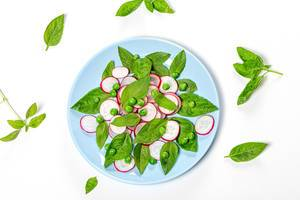 Top view fresh Basil leaves and radish slices on white background (Flip 2019)