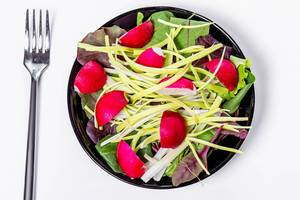 Top view fresh salad with spinach leaves, leeks and radishes (Flip 2019)