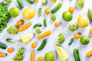 Top view fresh vegetables and fruits on white wooden background (Flip 2019)