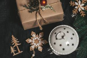 Top view gifts, lantern and Christmas decor on black background (Flip 2019)