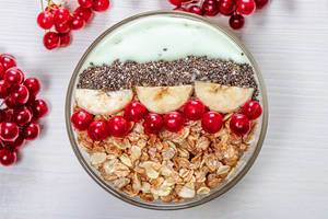 Top view oatmeal with Chia seeds, viburnum berries and banana slices (Flip 2019)