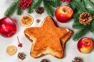 Top view of a homemade cake in the shape of a star on a Christmas background (Flip 2019)