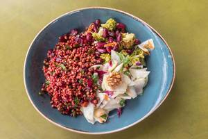 Top View of a Plate with Lentils, Radish, Brokkoli, Walnuts and Beetroot