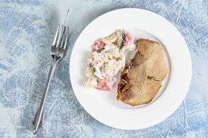 Top view of Baked Pork Chop with Serbian Sopska Salad