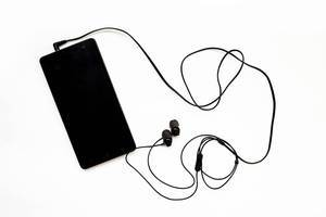 Top view of black smartphone connected with earphones isolated  Flip 2019