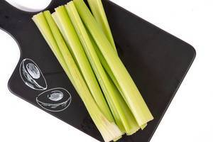 Top view of Celery Sticks on the black tray (Flip 2019)