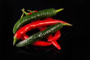 Top view of Chilli Hot Peppers above black background (Flip 2019)