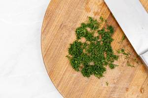 Top view of Chopped Parsley on the wooden board