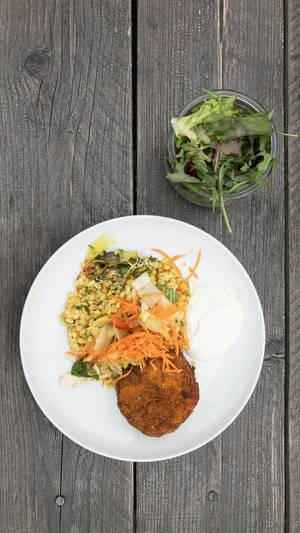 Top view of eggplant and potato croquettes with Ebly Zartweizen, veggie risotto with tarragon aioli and mixed salad