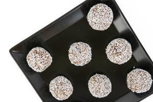 Top view of Energy Balls with Almonds Walnuts and Coconut on the black plate