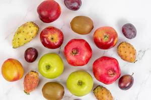 Top view of Fresh Fruits on the white table