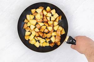 Top view of Fried Young Potatoes in the frying pan