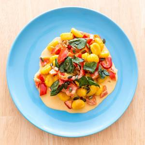 Top view of Gnocchi with pumpkin seeds in pepper sauce by Hellofresh