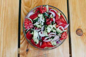 Top view of healthy salad with tomatoes, cucumbers and onion