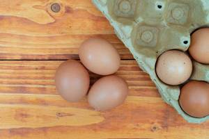 Top view of raw eggs in the cardboard box