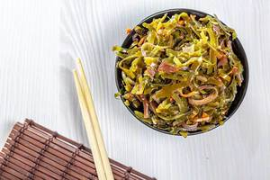 Top view of seaweed salad with chopsticks