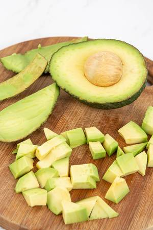 Top view of Sliced Avocado on the wooden board