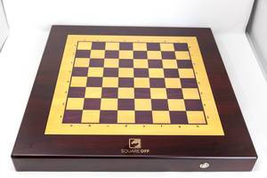 Top view of the entire battery-powered wooden chessboard from Square Off, playable against AI (artificial intelligence)