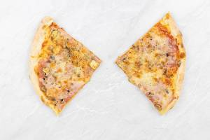 Top view of triangle Pizza slices above grey marble background table