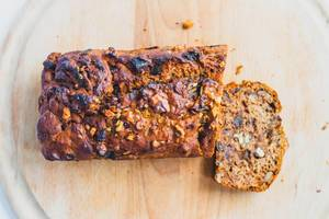 Top view of vegan date walnut bread on wooden board