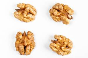 Top view of walnut kernel on a white background