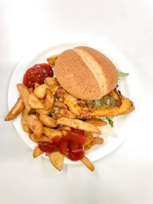 top view on plate with hamburger with breaded patty, aubergine, rocket salad and parmesan cheese, as a side dish crispy deep fried french fries with ketchup on white background