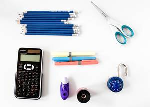Top View Photo of Calculator, Pencils, Markers, Scissors and other School Supplies on White Background