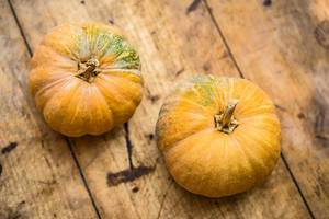 Top View Photo of two Pumpkins on Wooden Table