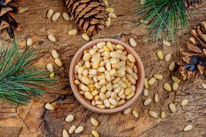 Top view, pine nuts with cones and pine branches on an old wooden background (Flip 2020)