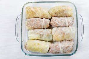 Top view raw cabbage rolls in glass baking pan (Flip 2019)
