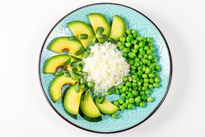 Top view rice with avocado, green peas and sunflower microgreen on a white background (Flip 2020)