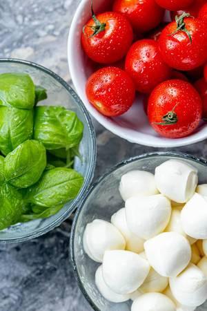 Top-view-ripe-tomatoes-fresh-garden-basil-and-mozzarella-cheese.jpg